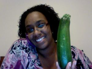 Me. Holding a Zucchini while talking on the phone.