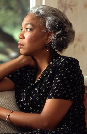 african american woman looking out a window